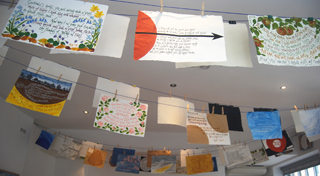 Paper Wings (artist's book installation),  text by Maureen Duffy: 55 poem/pages pegged on the line